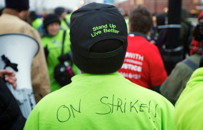 Striking Walmart store employee Tyrone Robinson protests outside a Walmart store in Chicago, November 23, 2012. Black Friday, the day following the Thanksgiving Day holiday, has traditionally been the busiest shopping day in the United States. REUTERS/John Gress