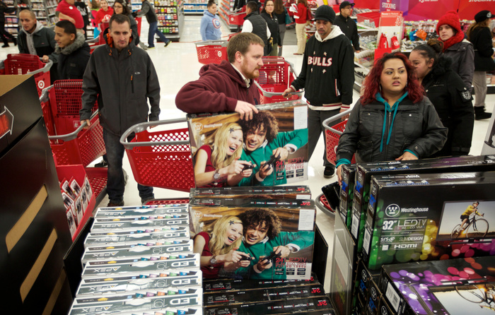 Black Friday shoppers pack a Target store in Chicago on November 22, 2012. Black Friday, the day following the Thanksgiving Day holiday, has traditionally been the busiest shopping day in the United States. REUTERS/John Gress