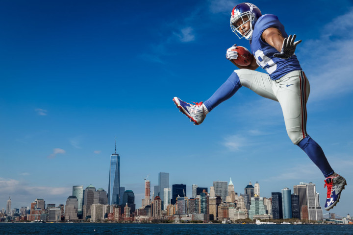 new york giants Paul Perkins poses for a portrait against the New York Skyline in this photo by Photographer John Gress