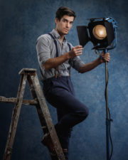 Chicago mens fashion photographer actor on ladder with movie light