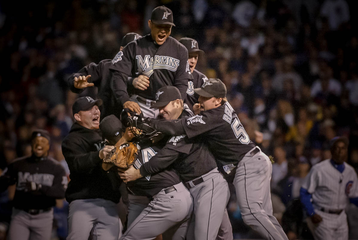 The Florida Marlins celebrate defeating the Chicago Cubs in