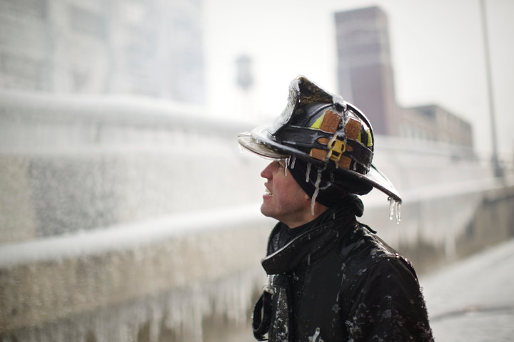 Chicago Firefighter Michael De Jesus is covered in ice as he mans a water cannon while fighting a warehouse fire January 24, 2013, which caught fire Tuesday night in Chicago.  Fire Department officials said it is the biggest fire the department has had to battle in years. One-third of all Chicago firefighters were on the scene at one point or another trying to put out the flames. REUTERS/John Gress (UNITED STATES)