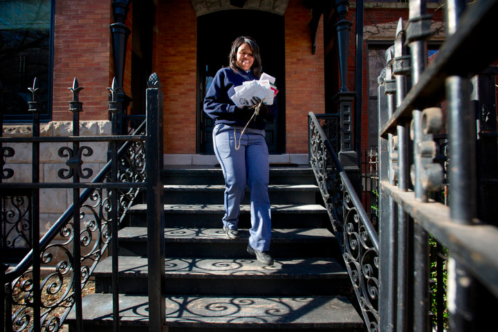 United States Postal Service Letter Carrier Lakesha Dortch-Hardy delivers mail in Chicago