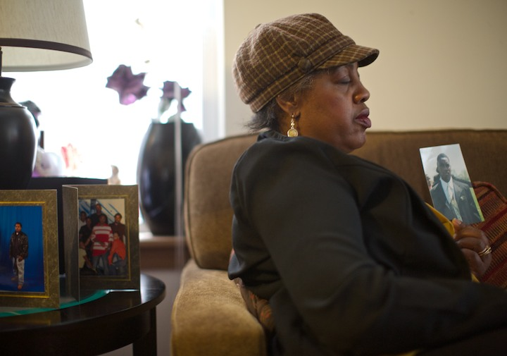 Shirley Chambers holds a photo in her Chicago living room, January 30, 2013, showing her son Ronnie attending her other son Jerome's funeral July 2000. REUTERS/John Gress (UNITED STATES)