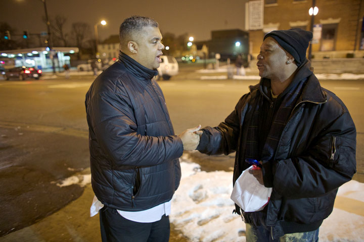 Pastor Greg Livingston of Mission Baptist Church talks with Kelvin Atwood during a weekly street patrol in Chicago.(Photo: John Gress for USA TODAY)