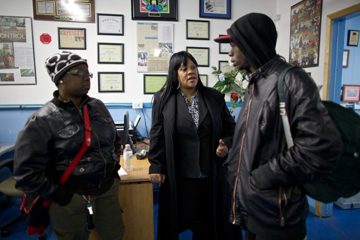 Activist Diane Latiker speaks with Tito Keenan in her Chicago office.(Photo: John Gress for USA TODAY)