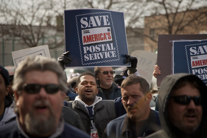 CHICAGO - FEBRUARY 19: Members of the National Association of Letter Carriers and American Postal Workers Union protest in support of Saturday mail delivery outside a post office February 19, 2013 in Chicago, Illinois. The United States Postal Service has announced that they plan to end Saturday mail delivery on August 5th. (Photo by John Gress/Getty Images)