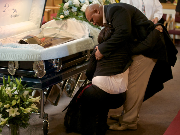 Shirley Chambers collapses during a funeral for he son Ronnie Chambers on February 4, 2013 in Chicago. He was the last of the single mother's children - all victims of gun violence over a period of 18 years. REUTERS/John Gress (UNITED STATES)