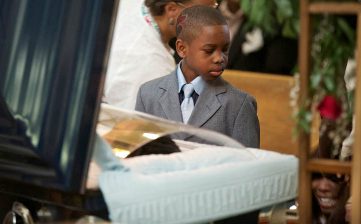 Ronnie Chambers Jr. looks down towards his collapsed mother Tahitah Myles during a funeral for the boys father Ronnie Chambers on February 4, 2013 in Chicago. Shirley Chambers of Chicago had four children - three boys and a girl. Now they're all gone. Her son, Ronnie Chambers. was the last of the single mother's children ' all victims of gun violence in Chicago over a period of 18 years.s. REUTERS/John Gress