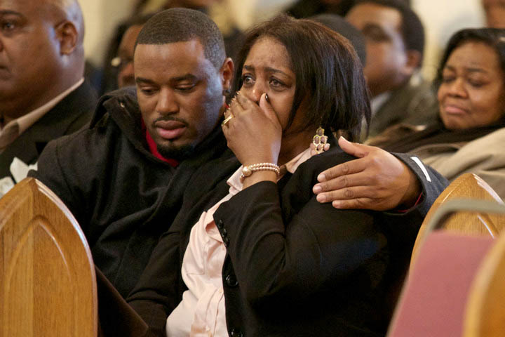 Shirley Chambers cries during a funeral for he son Ronnie Chambers on February 4, 2013 in Chicago. He was the last of the single mother's children - all victims of gun violence over a period of 18 years. REUTERS/John Gress