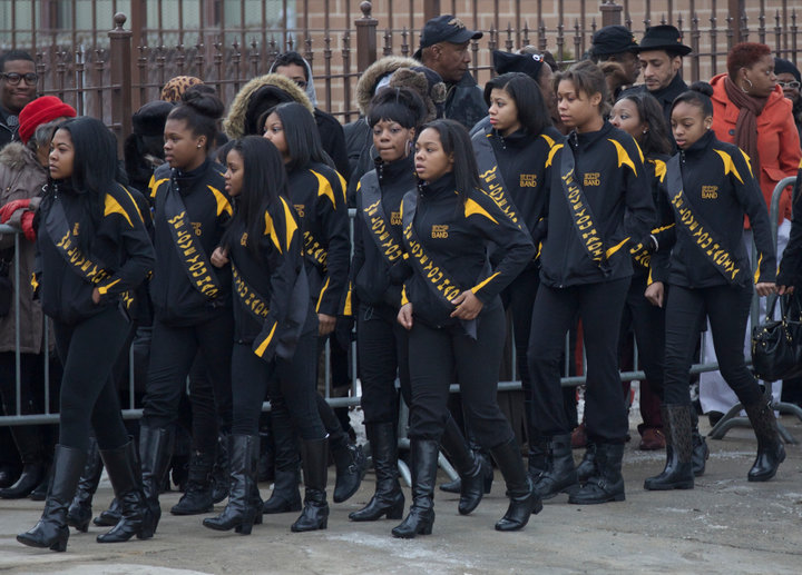 King College Prep majorettes gather outside Hadiya Pendleton's funeral in Chicago, February 9, 2013. Pendleton, 15, was fatally shot on Jan. 29 as she and her friends shielded themselves from rain under a canopy in a Chicago park in what police say was a case of mistaken identity in a gang turf war. Pendleton, a sophomore at Martin Luther King Jr. College Prep, had performed with her school band eight days earlier at President Barack Obama's inauguration. A $40,000 reward has been offered in the case. REUTERS/John Gress (UNITED STATES)