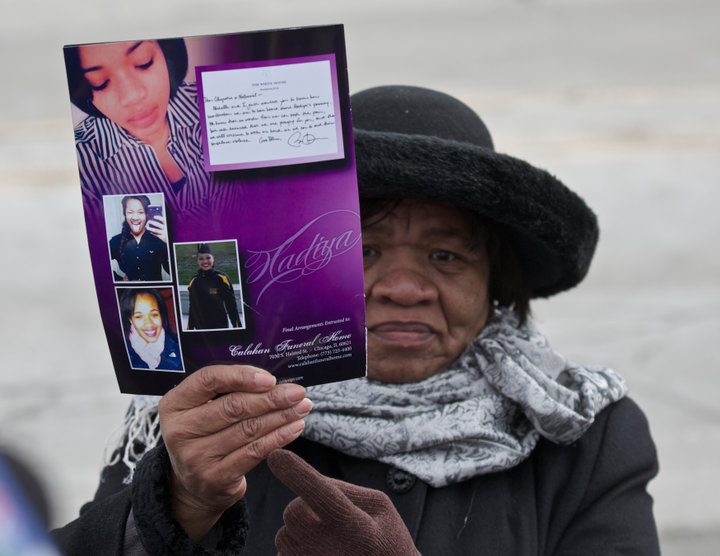 A mourner cries holds up a program for Hadiya Pendleton's funeral in Chicago, February 9, 2013. Pendleton, 15, was fatally shot on Jan. 29 as she and her friends shielded themselves from rain under a canopy in a Chicago park in what police say was a case of mistaken identity in a gang turf war. Pendleton, a sophomore at Martin Luther King Jr. College Prep, had performed with her school band eight days earlier at President Barack Obama's inauguration. A $40,000 reward has been offered in the case. REUTERS/John Gress (UNITED STATES)