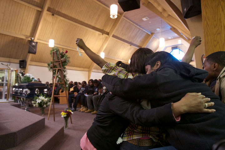Tahitah Myles (hands raised) is comforted during funeral services for Ronnie Chambers, the father of her son, Ronnie Chambers Jr. on February 4, 2013 in Chicago. Shirley Chambers of Chicago had four children - three boys and a girl. Now they're all gone. Her son, Ronnie Chambers. was the last of the single mother's children - all victims of gun violence in Chicago over a period of 18 years. REUTERS/John Gress