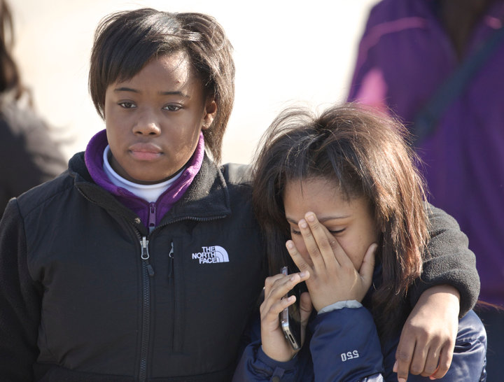 Mourners leave a funeral for Hadiya Pendleton in Chicago, February 9, 2013. Pendleton, 15, was fatally shot on Jan. 29 as she and her friends shielded themselves from rain under a canopy in a Chicago park in what police say was a case of mistaken identity in a gang turf war. Pendleton, a sophomore at Martin Luther King Jr. College Prep, had performed with her school band eight days earlier at President Barack Obama's inauguration. A $40,000 reward has been offered in the case. REUTERS/John Gress (UNITED STATES)