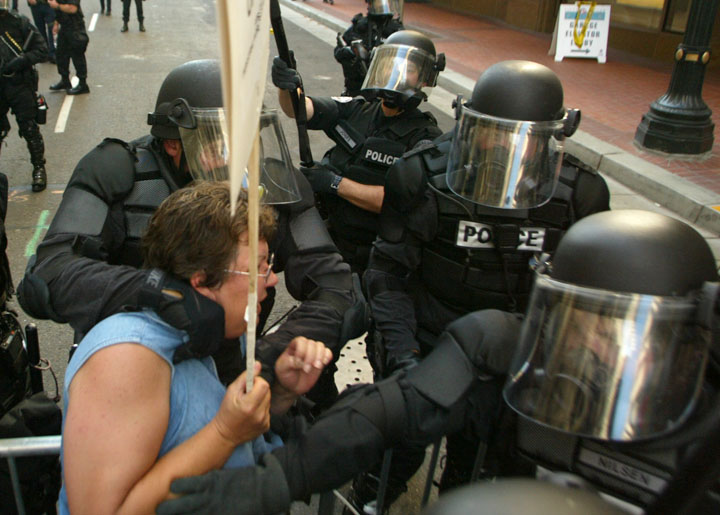 Police grab a protester as police clear the streets around an event with President Bush in downtown, Portland, Ore., Thursday, Aug. 22, 2002.(AP Photo/John Gress)