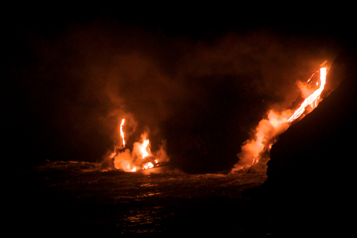 Lava from the Mount Kilauea volcano flows into the Pacific Ocean at night, March 1, 2013.
