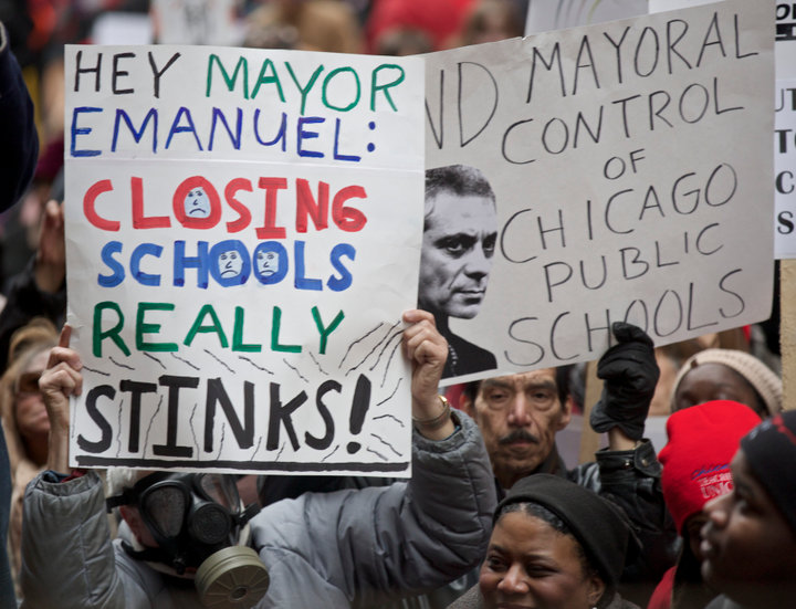 Demonstrators react during a Chicago Teachers Union protest in Chicago, March 27, 2013. Thousands of demonstrators rallied in downtown Chicago on Wednesday to protest the city's plan to close 54 public schools, primarily in Hispanic and African-American neighborhoods. The closings, which the school board plans to vote on in May, would be the biggest one-time shutdown ever by a U.S. city. Wednesday's demonstration, organized by the teacher's union, drew parents, students and other critics of the plan. REUTERS/John Gress (UNITED STATES)