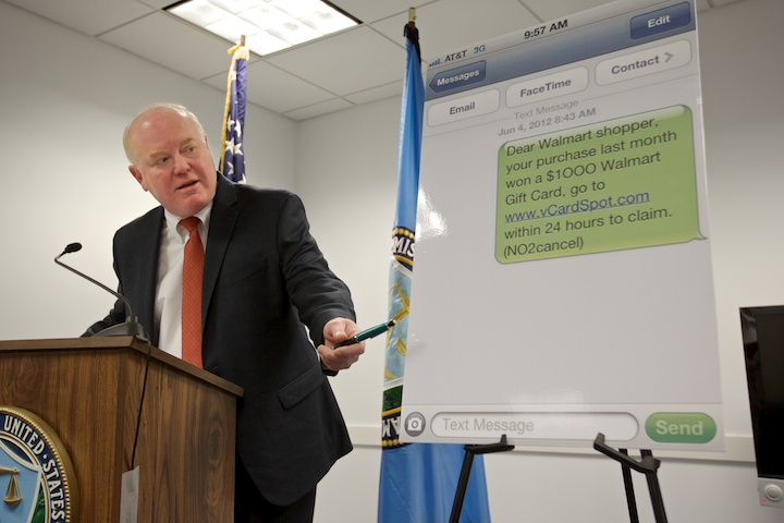 The Federal Trade Commission Midwest regional director Steve Baker speaks during a press conference about spam text messages in Chicago, March 7, 2013.
