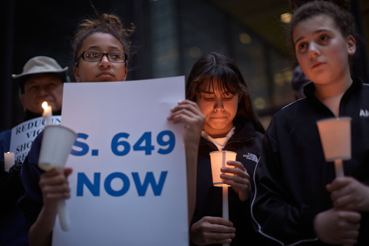 Kayla Figueroa, 12, pauses during an Organizing for Action candlelight vigil against gun violence in Chicago, April 13, 2013. REUTERS/John Gress 1/160 f1.2 ISO320 50mm