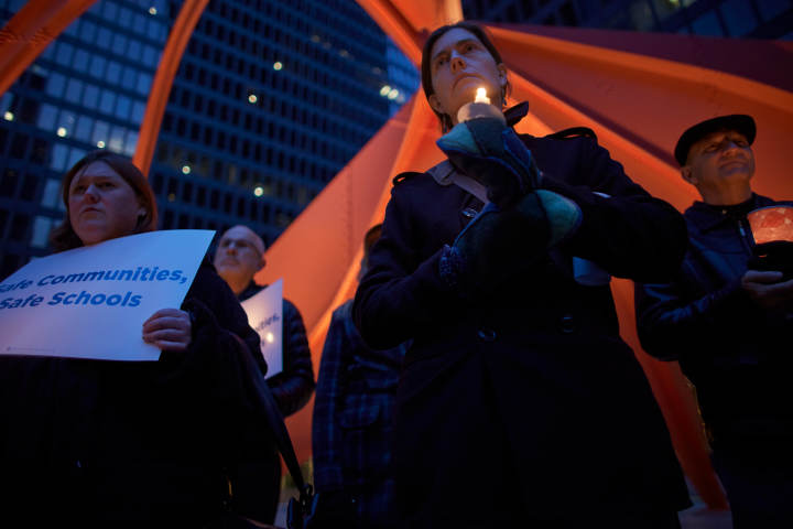 Demonstrators attend an Organizing for Action candlelight vigil against gun violence in Chicago, April 13, 2013. REUTERS/John Gress