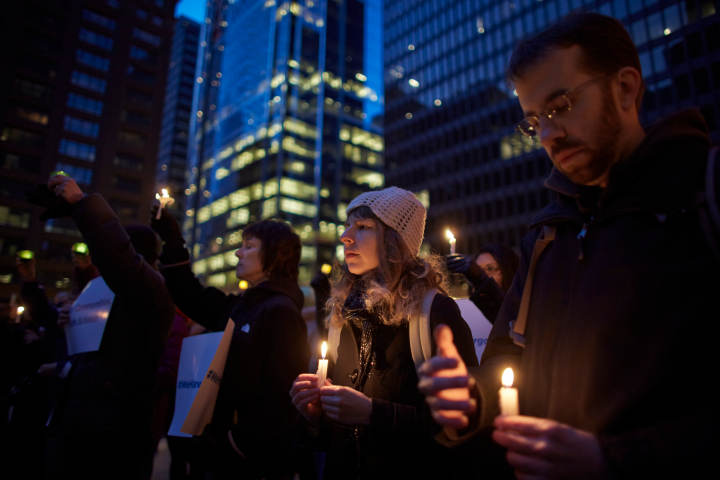 Erica Sagrans (2nd R) attends an Organizing for Action candlelight vigil against gun violence in Chicago, April 13, 2013. REUTERS/John Gress