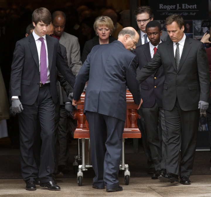 Pallbearer's including film critic Richard Roeper (R ) move the remains of Film critic Roger Ebert after his funeral in Chicago, April 8, 2013. REUTERS/John Gress (UNITED STATES)