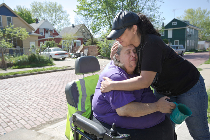 Neighbor Sandra Guisao hugs Deborah Knight, grandmother of Michelle Knight, outside her Cleveland, Ohio, home May 9, 2013. ThreeÊClevelandÊwomen, including Michelle, were found alive after vanishing in their own neighborhood about a decade ago. REUTERS/John Gress