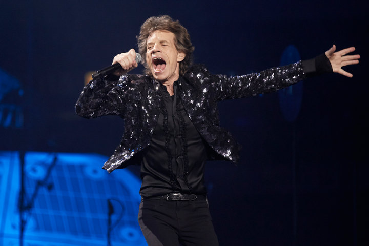 "Mick Jagger of the Rolling Stones perform at a concert during the band's ""50 and Counting"" tour in Chicago May 28, 2013.REUTERS/John Gress"
