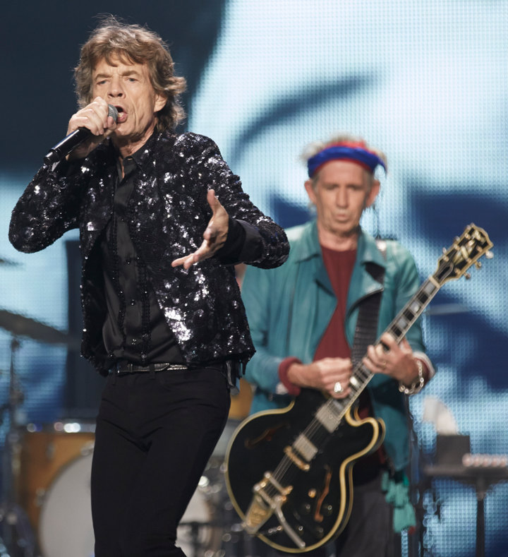"Mick Jagger and Keith Richards of the Rolling Stones perform at a concert during the band's ""50 and Counting"" tour in Chicago May 28, 2013.REUTERS/John Gress"