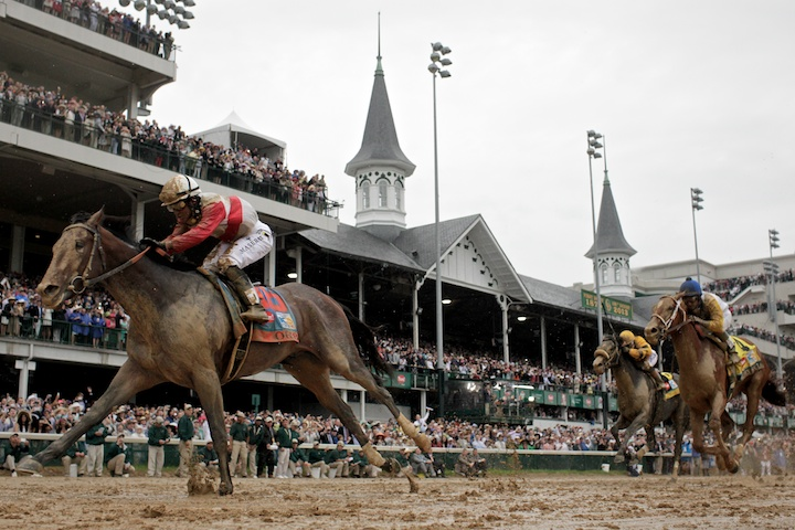 Orb, ridden by jockey Joel Rosario (L), passes the famous twin spires and crosses the finish first during the running of the 139th Kentucky Derby horse race at Churchill Downs in Louisville, Kentucky, May 4, 2013. REUTERS/John Gress