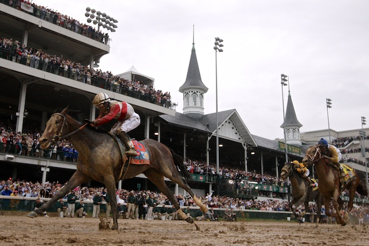 Orb, ridden by jockey Joel Rosario (L), passes the famous twin spires and crosses the finish first during the running of the 139th Kentucky Derby horse race at Churchill Downs in Louisville, Kentucky, May 4, 2013.