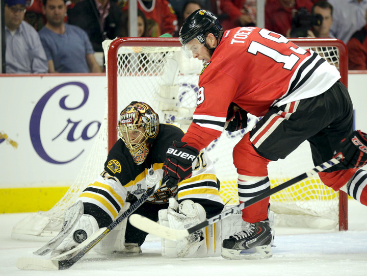 Boston Bruins goalie Tuukka Rask (40) makes a second period save on Chicago Blackhawks center Jonathan Toews (19) during Game 1 of their NHL Stanley Cup Finals hockey series in Chicago, Illinois, June 12, 2013. REUTERS/John Gress