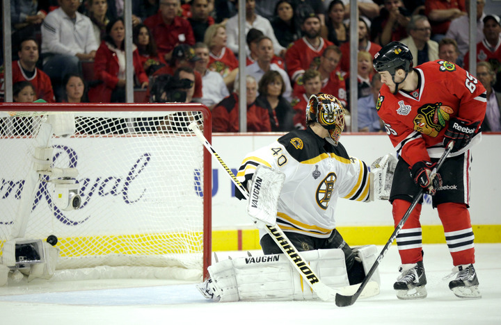 Chicago Blackhawks center Andrew Shaw (65) scores in triple-overtime on Boston Bruins goalie Tuukka Rask (40) to win Game 1 of their NHL Stanley Cup Finals hockey series in Chicago, Illinois, June 13, 2013. REUTERS/John Gress
