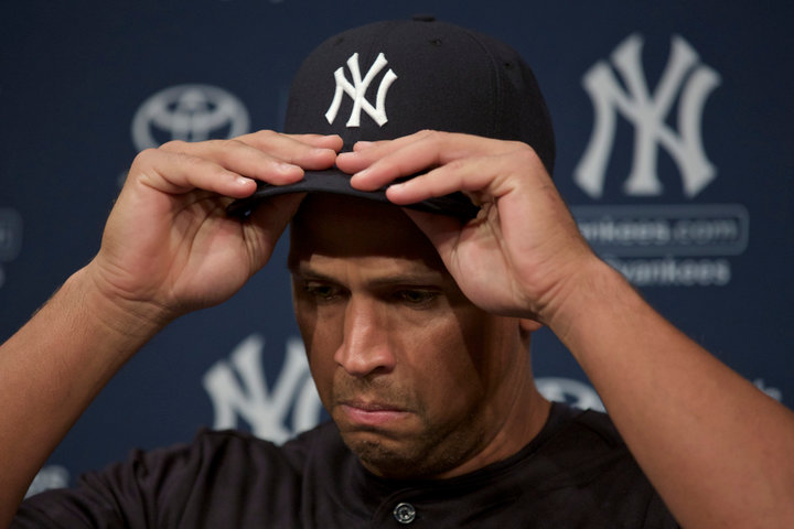 New York Yankee Alex Rodriguez adjusts his hat while speaking during a press conference in Chicago, August 5, 2013. REUTERS/John Gress (UNITED STATES)
