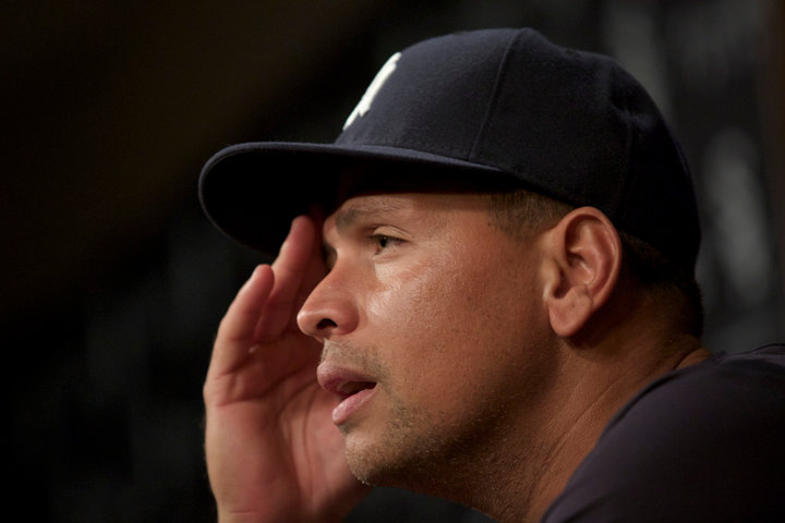 New York Yankee Alex Rodriguez pauses while speaking during a press conference in Chicago, August 5, 2013. REUTERS/John Gress (UNITED STATES)