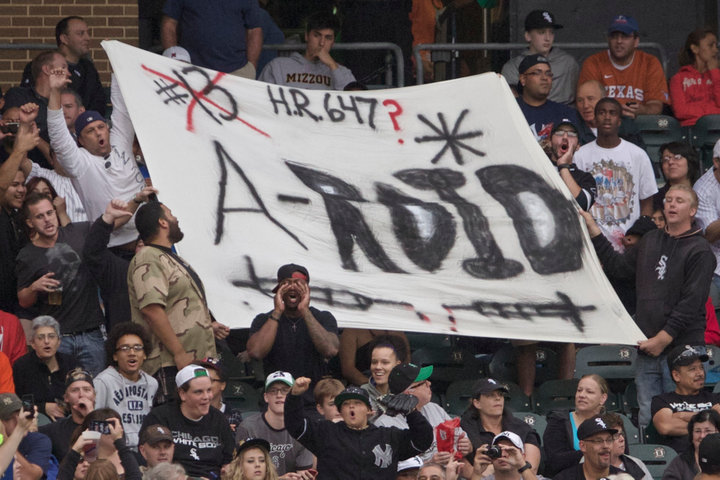 Fans hold up a sign as New York Yankee's Alex Rodriguez prepares to bat while playing the Chicago White Sox in the second inning of their MLB game in Chicago, August 5, 2013. REUTERS/John Gress (UNITED STATES)