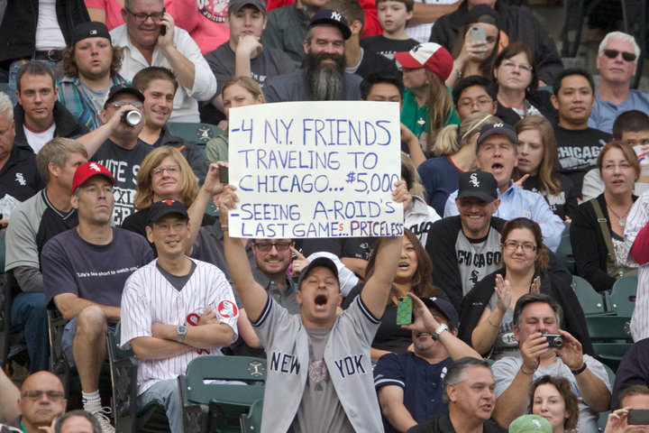A fans hold up a sign as New York Yankee's Alex Rodriguez prepares to bat while playing the Chicago White Sox in the second inning of their American League MLB game in Chicago, August 5, 2013. REUTERS/John Gress (UNITED STATES)