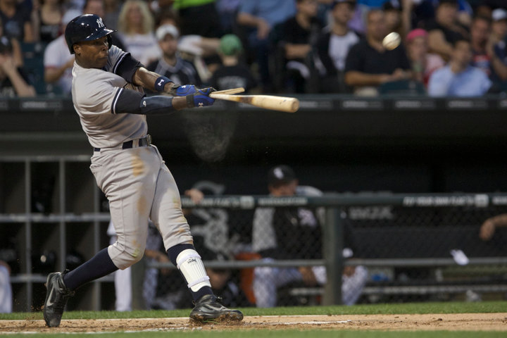 New York Yankees Alfonso Soriano breaks his bat while playing the Chicago White Sox during the third inning of in their American League MLB game in Chicago, August 6, 2013. REUTERS/John Gress (UNITED STATES)