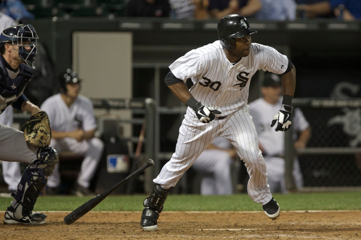 Chicago White Sox Alejandro De Aza hits a two RBI double off of the New York Yankees in the 12th inning of their American League MLB baseball game in Chicago, August 7, 2013. REUTERS/John Gress (UNITED STATES)