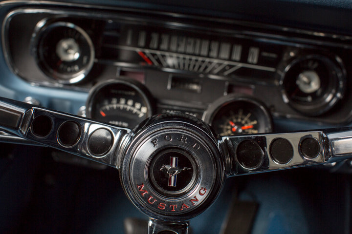 The steering wheel of Gail Wise's Skylight Blue 1964 1/2 Ford Mustang convertible is seen in Park Ridge, Illinois November 26th, 2013. REUTERS/John Gress