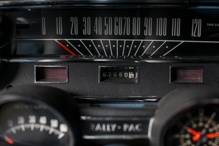 The odometer of Gail Wise's Skylight Blue 1964 1/2 Ford Mustang convertible displays the cars 67,000 original miles in Park Ridge, Illinois November 26th, 2013. REUTERS/John Gress
