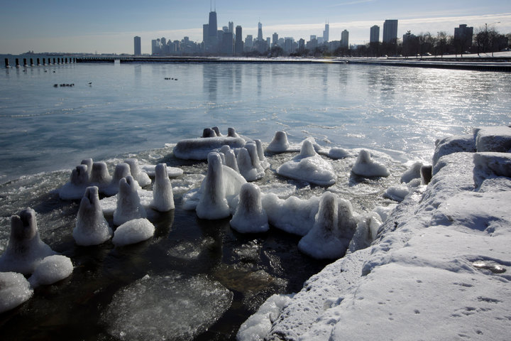 Ice covers the shore of Lake Michigan In Chicago where temperatures have dropped well below freezing. REUTERS/John Gress (UNITED STATES)