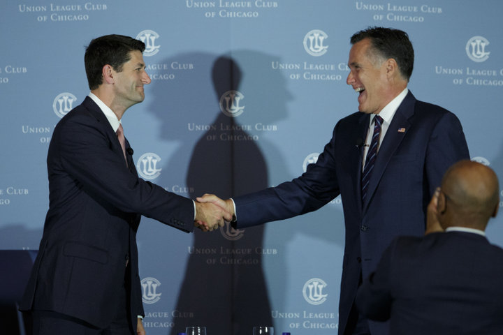 """CHICAGO,IL - AUGUST 21: Former Massachusetts Governor Mitt Romney shakes hands with his former running mate U.S. Rep. Paul Ryan (R-WI) on August 21, 2014 in Chicago. The duo was on hand to publicize Ryan's new book, """"The Way Forward."""" (Photo by John Gress/Getty Images)"""