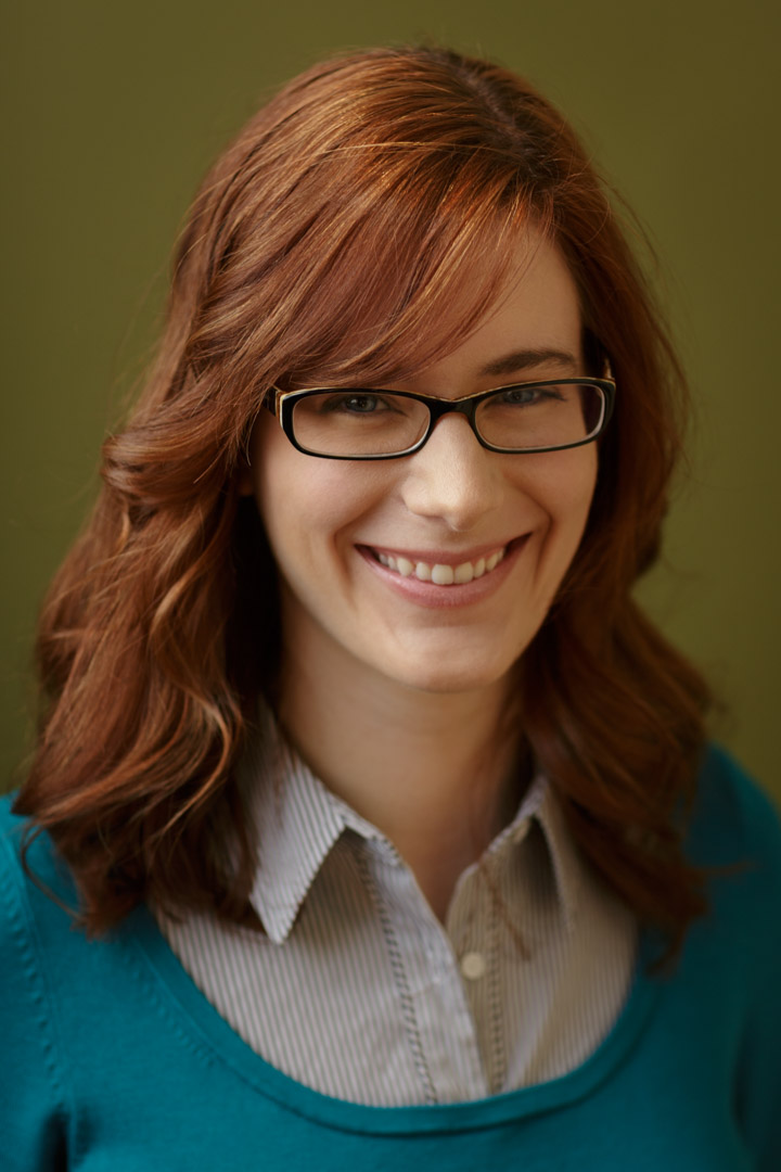 Chicago Actor Headshots female actror with glasses smiling in simple natural photo