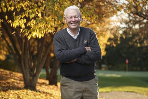 David Cookson poses for a portrait photographer in Madison