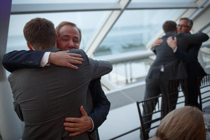 Gay wedding photography chicago sons hug dads