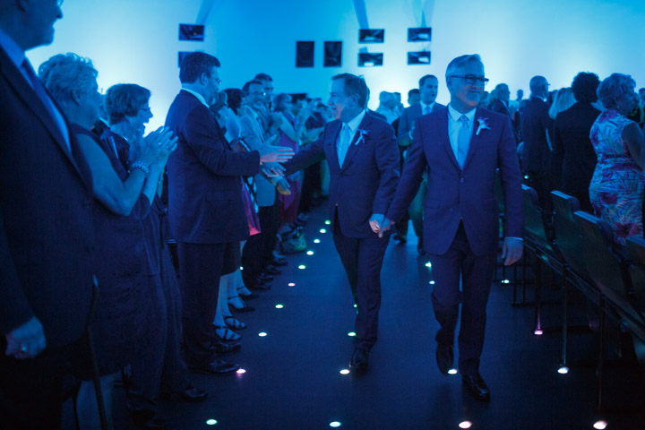 Gay Wedding Photography Chicago shows couple exiting their ceremoy