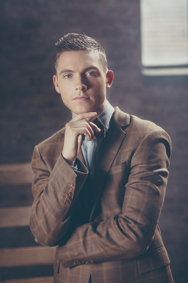 Chicago Fashion Photographer blond male model bow tie headshot