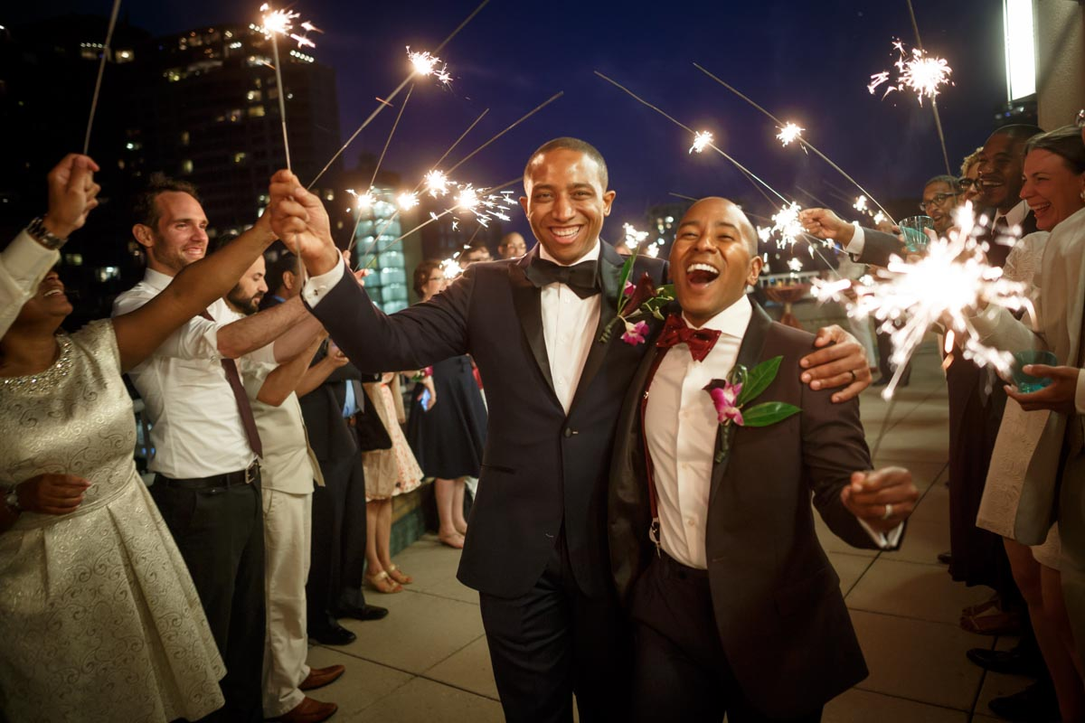 Evanston Gay Wedding photographer Ramon & Cecil arrive at their cocktail hour with sparklers in hand.