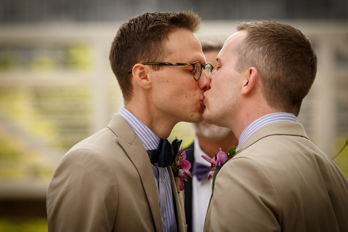Illinois LGBT Wedding Photography first kiss at the Peggy Notebaert Nature Museum in Chicago